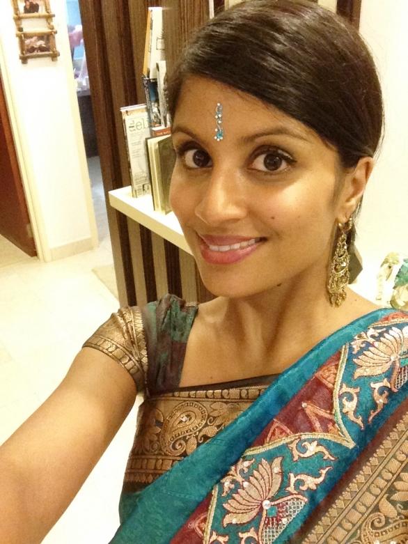 Wearing a sari but still not Indian.
