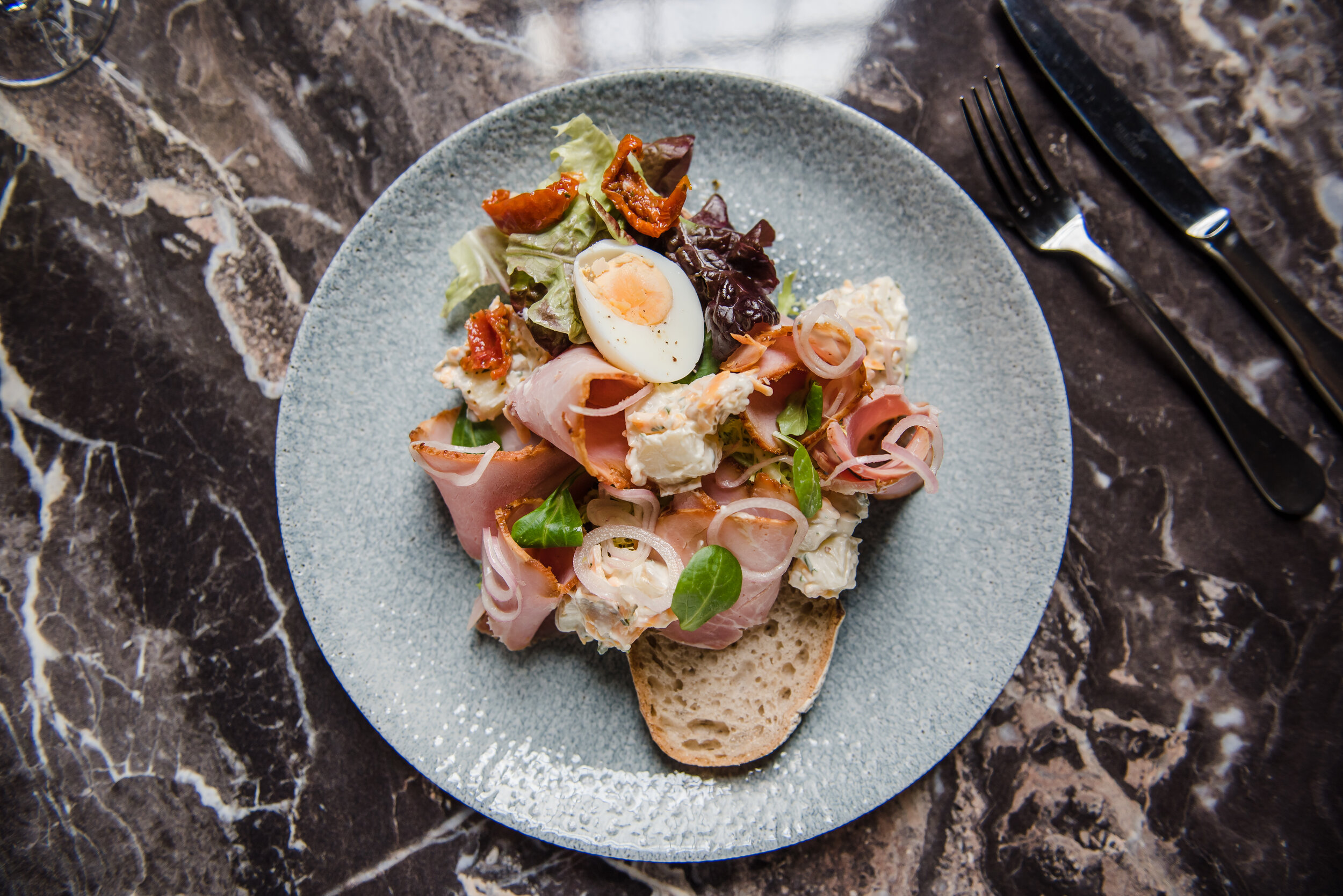 SMØRREBRØD - This is our '1485' sandwich which celebrates the foundation of the Drapers Guild at 10 St. Mary's Place. It's made with home cured ham, cheesy potato salad and pickled onion and comes complete with a side salad for just £5.95
