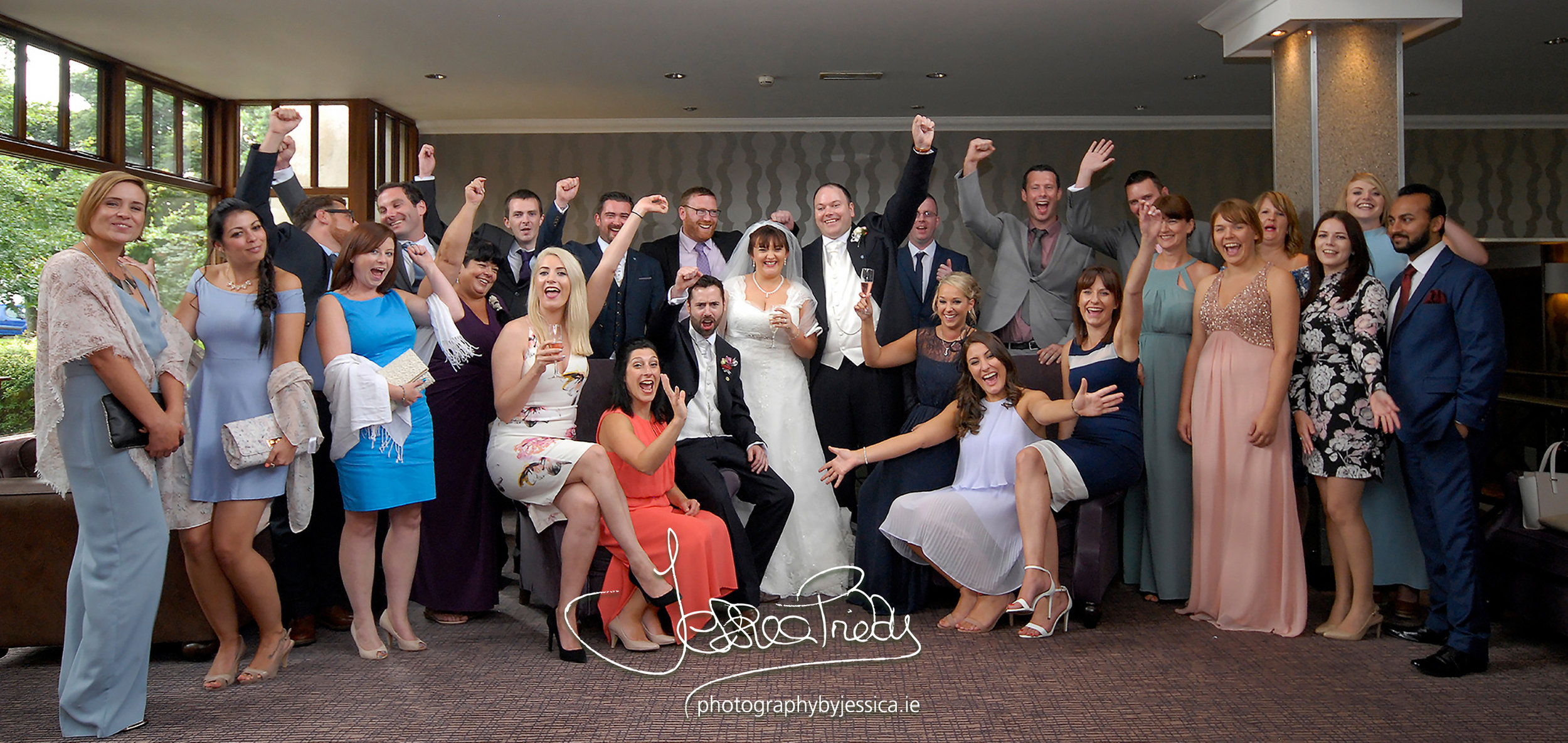 Wedding guests celebrating with the Bride and Groom