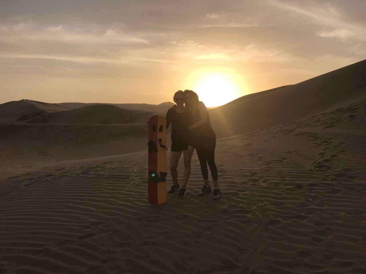 Sand boarding in Huacachina Oasis in Ica
