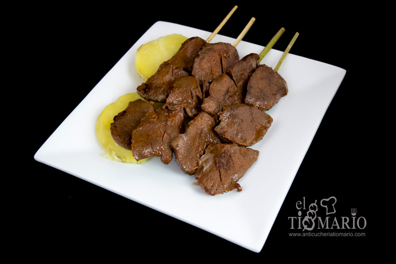 Cow hearts come on a skewer with a side of boiled, skinned potatoes. Don't forget to ask for sauces!