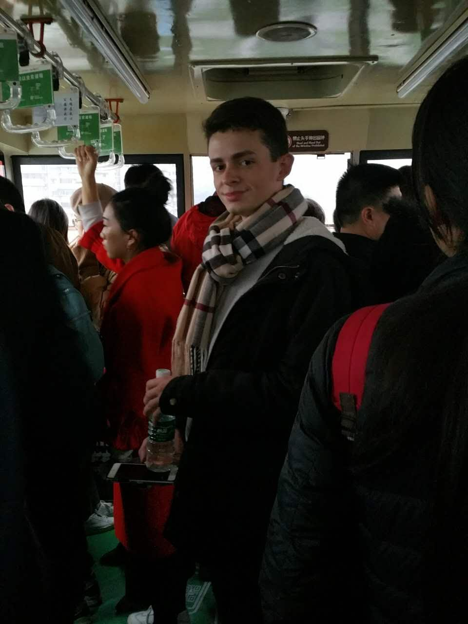 I'm on a cable car going over a river in Chongqing!