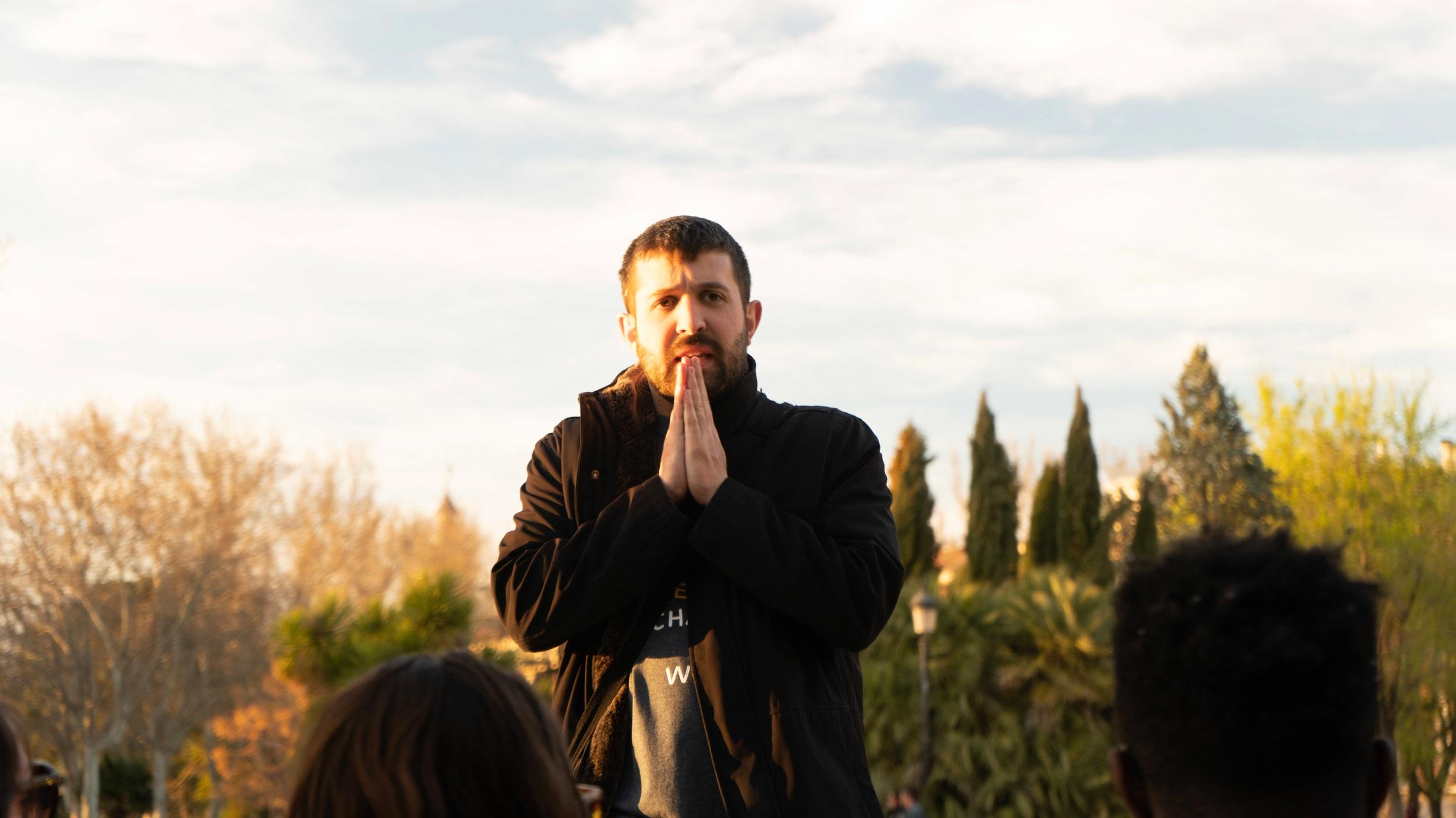 Author Joe Meringolo, Director of Program Development, leads a group reflection in Madrid's Parque Oeste (West Park).