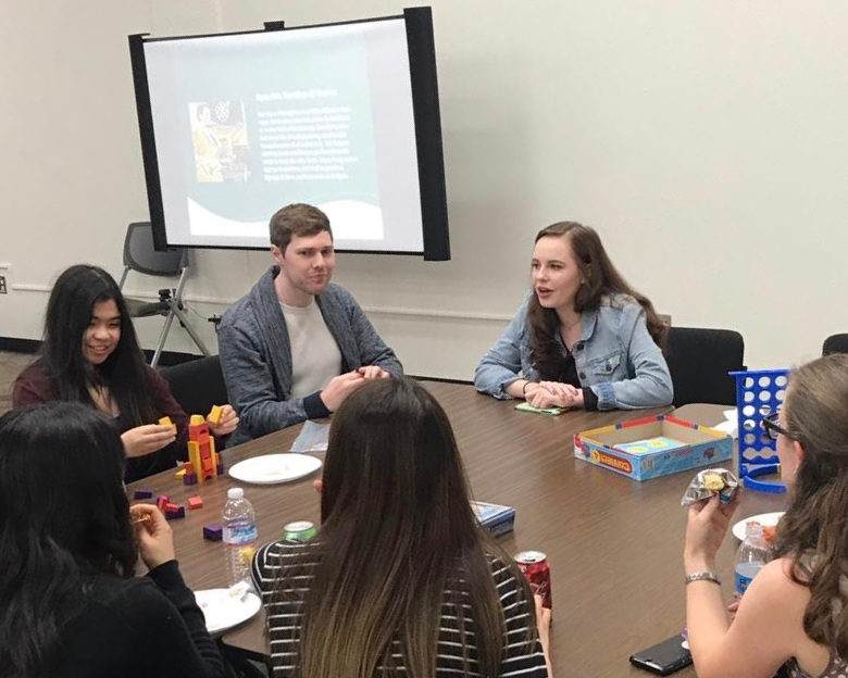 EdOdyssey Marketing Intern Amanda Lowrey (right) shares her experience with peers during a study abroad mixer.