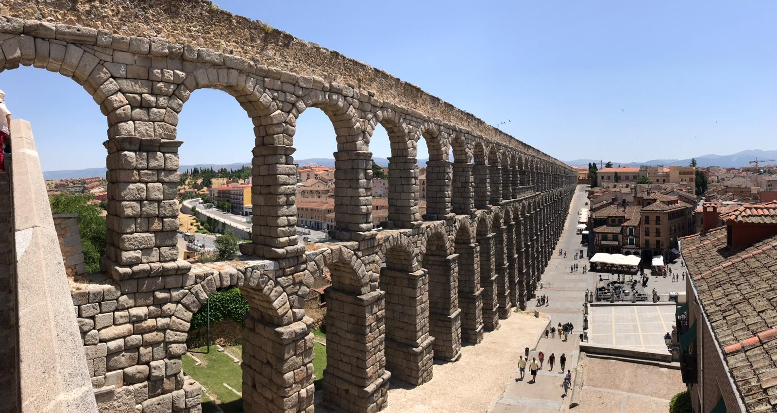 Pictured: Aqueduct of Segovia, which was built during the second half of the 1st century A.D., this is an hour's drive away from the center of Madrid, Spain.