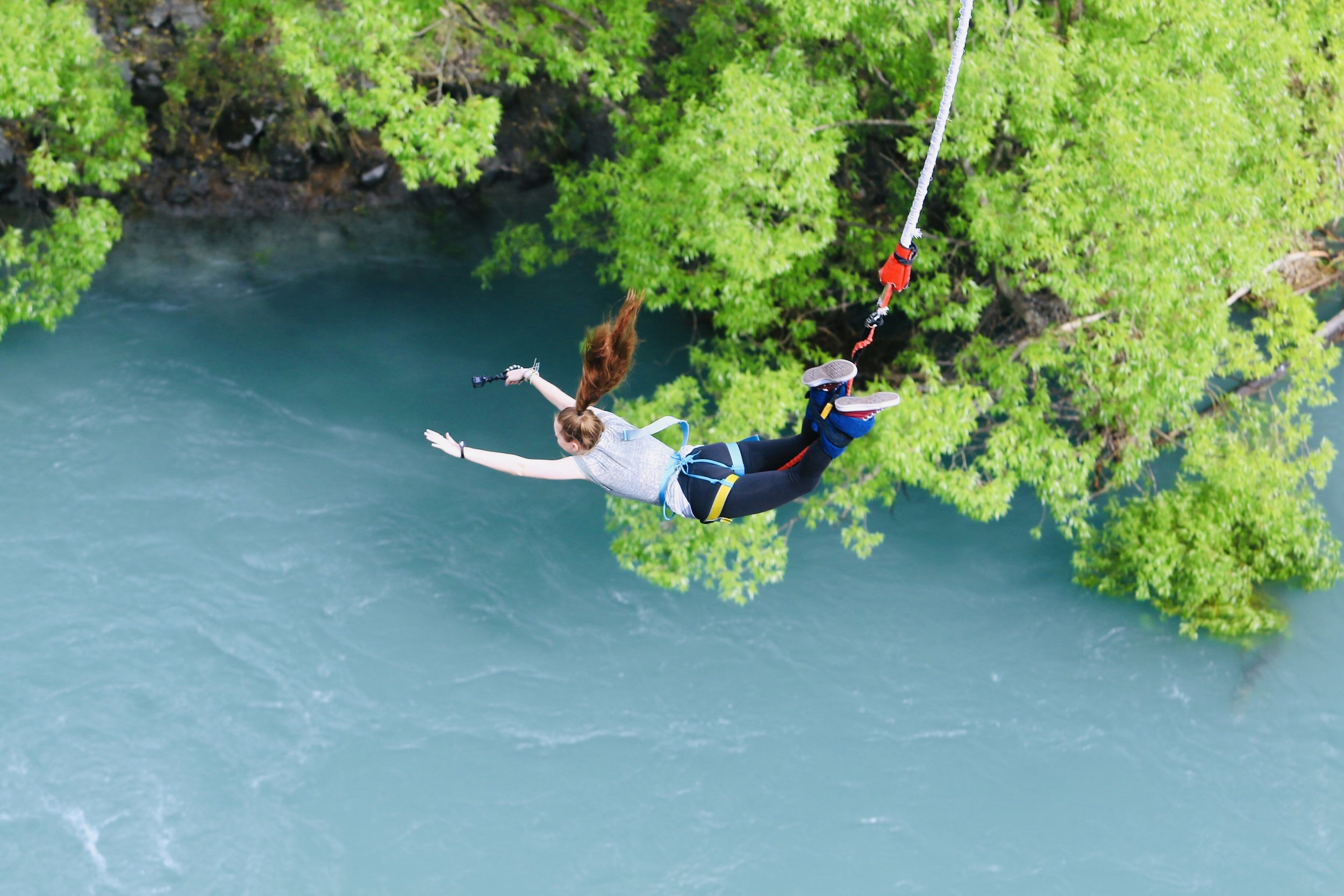 EdOdyssey Marketing Intern Amanda Lowrey bungee jumping, with her GoPro in hand, over the Kawarau river in Queenstown, NZ.