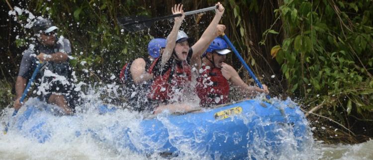 Amanda Lowrey having the time of her life white watering rafting in Quepos, Costa Rica.