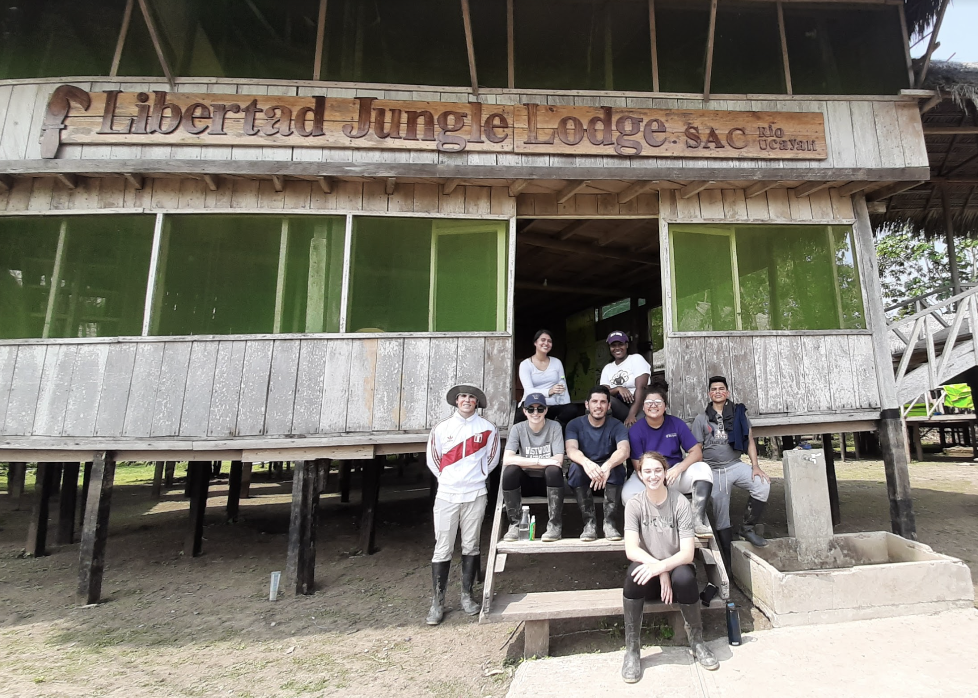 The group posed in front of the Libertad Jungle Lodge, an accommodation and community within the Iquitos area of Peru.