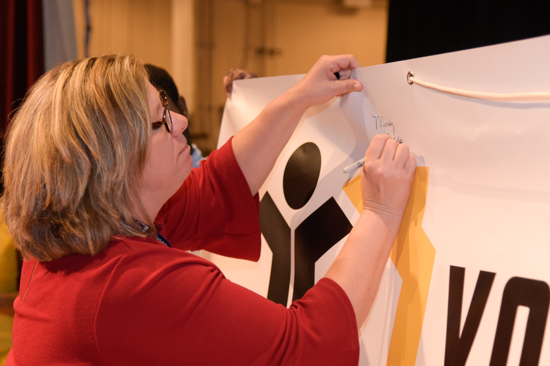 Director of YouthBuild Johnstown, Mindy Rickabaugh, signing the coalition banner