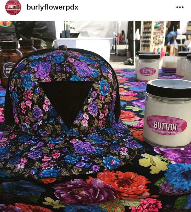 Y'all know about @burlyflowerpdx right? This body buttah is a dream that smells like chocolate ❤️ check out the granny core table display with the limited edition QK hat! I only made two of these so they are sold out but there's plenty of others!! #queerkuntry #queerapparel #queerhats