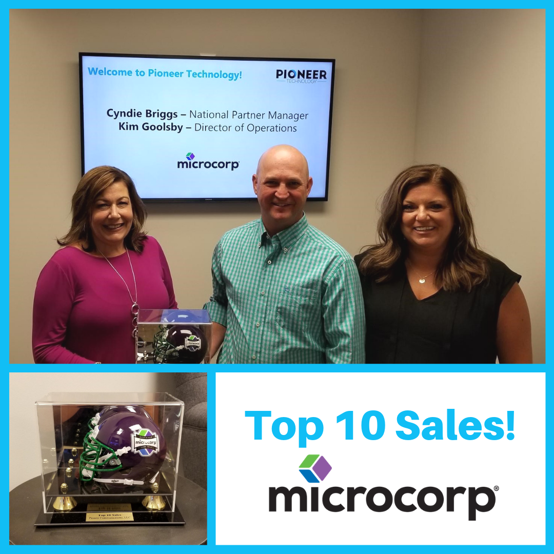 Cyndie Briggs and Kim Goolsby of MicroCorp deliver Top Ten Sales award to Randy King, VP Business Development for Pioneer Technology