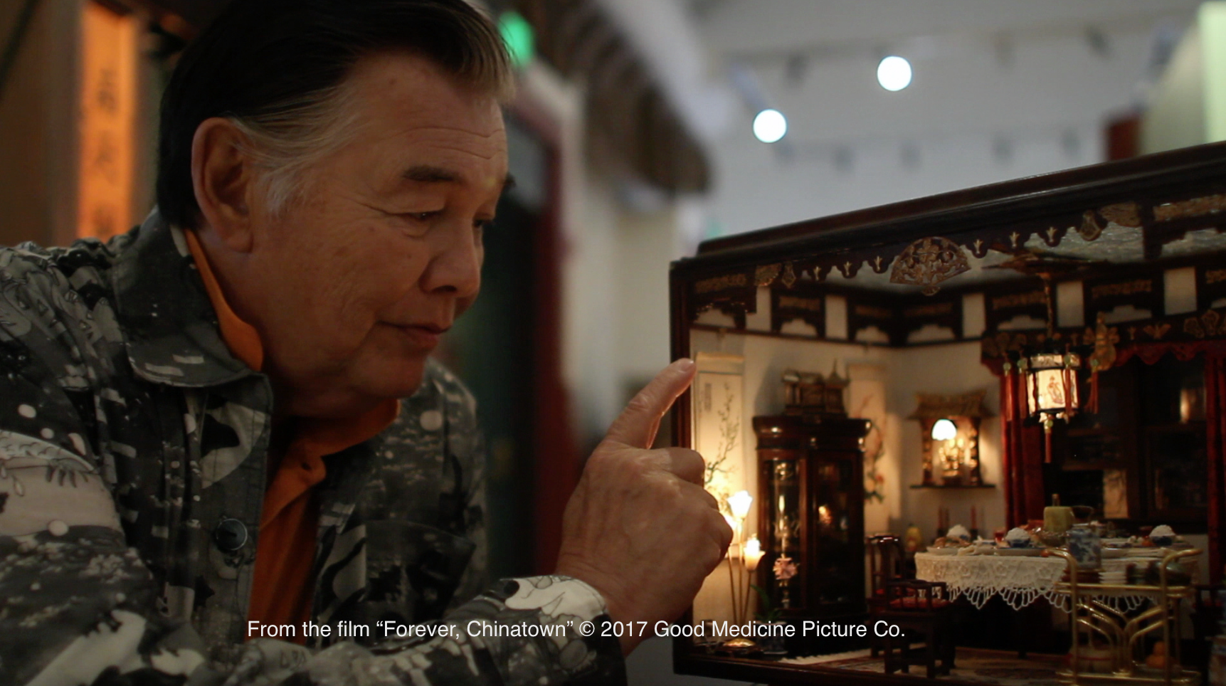 "Artist Frank Wong with the ""Dining Room"" Miniature model."