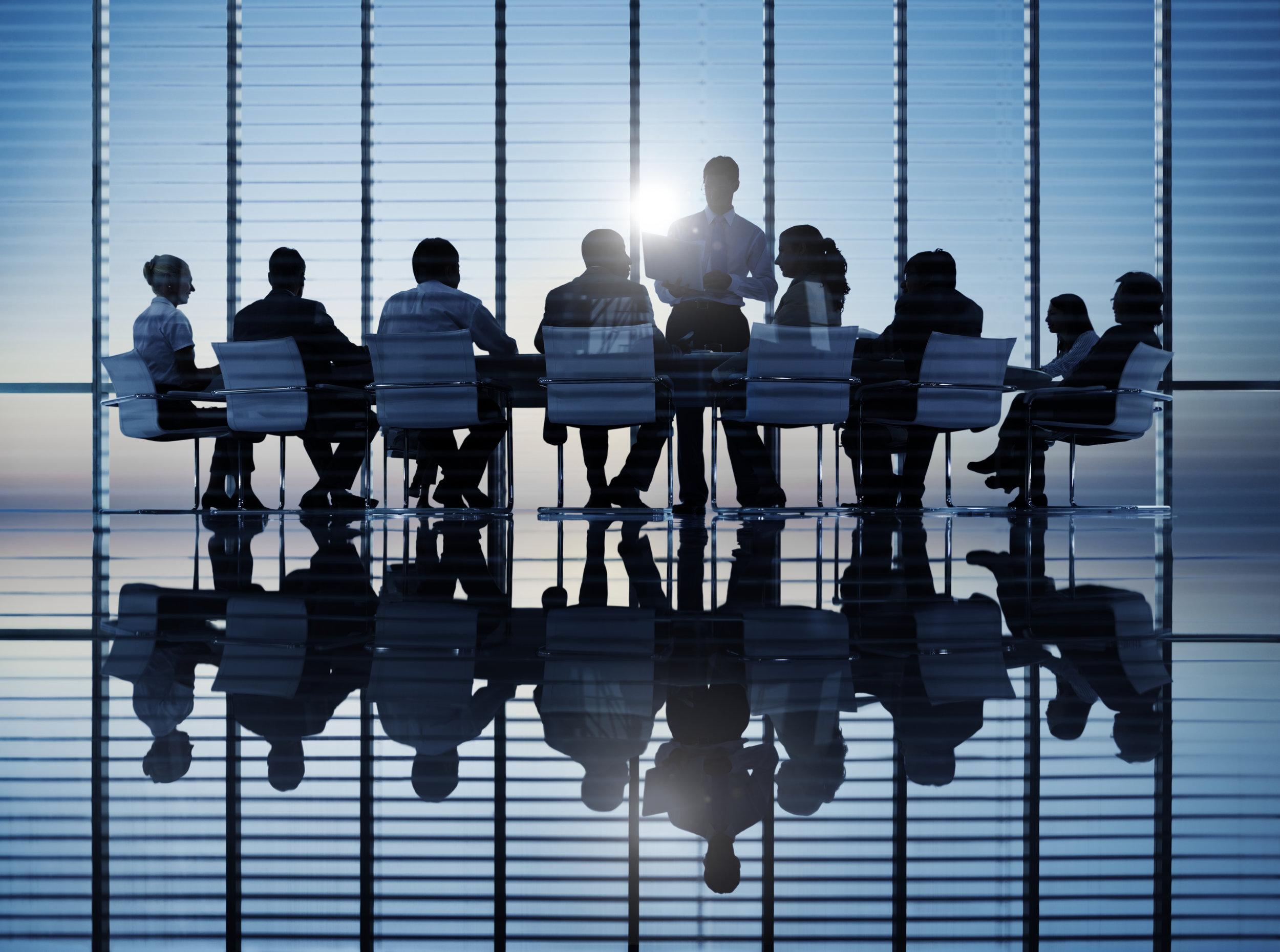 bigstock-Business-people-in-a-board-roo-209994802.jpg