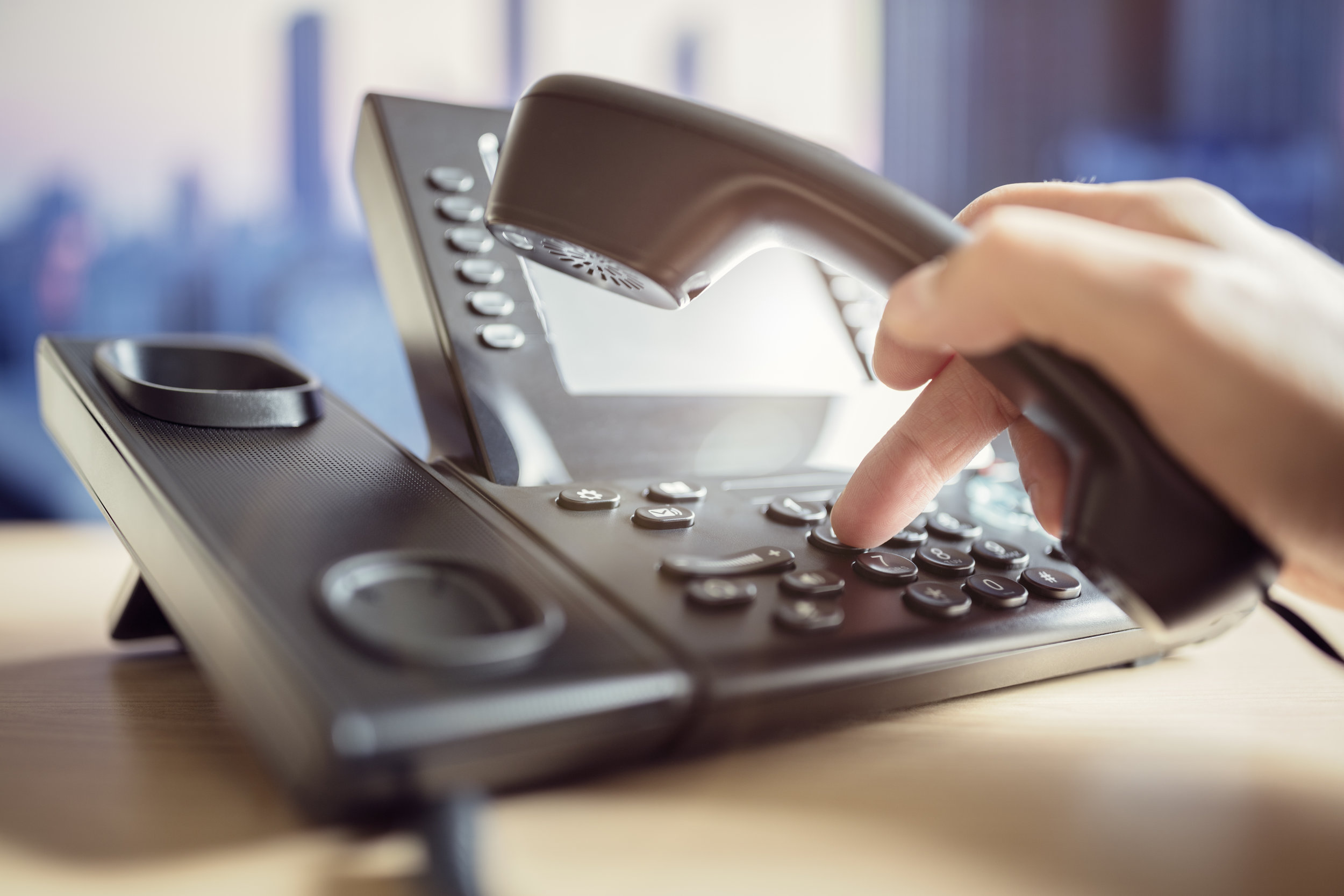 bigstock-Dialing-telephone-keypad-conce-168083717.jpg