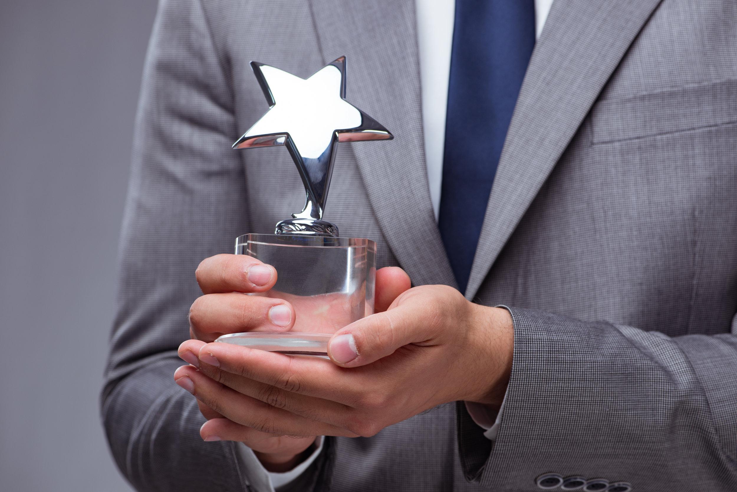 bigstock-Businessman-holding-star-award-198698806.jpg