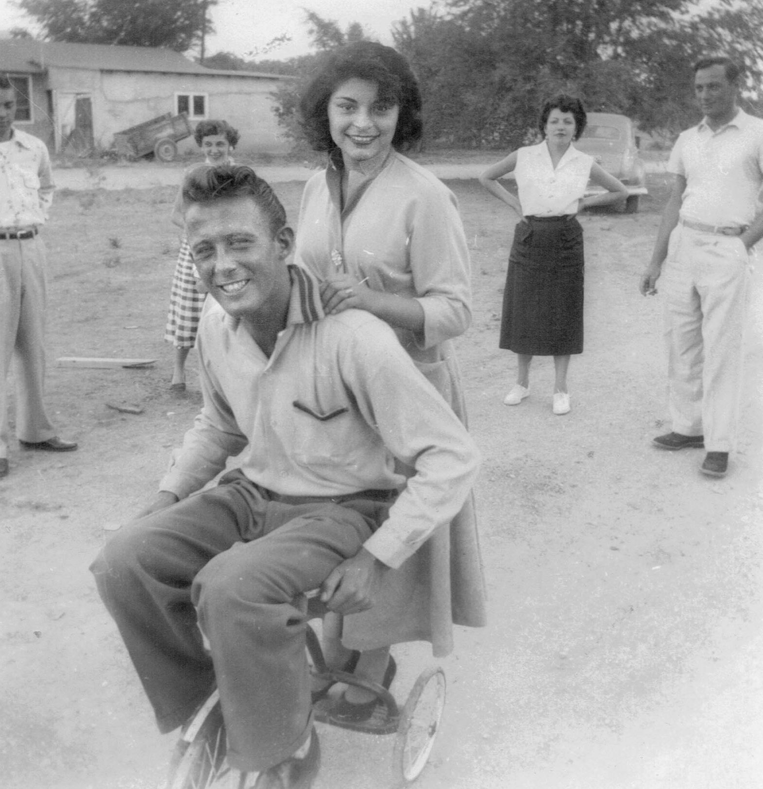 The newly extended family in Albuquerque, circa 1950. Steve and Molly on a tricycle.