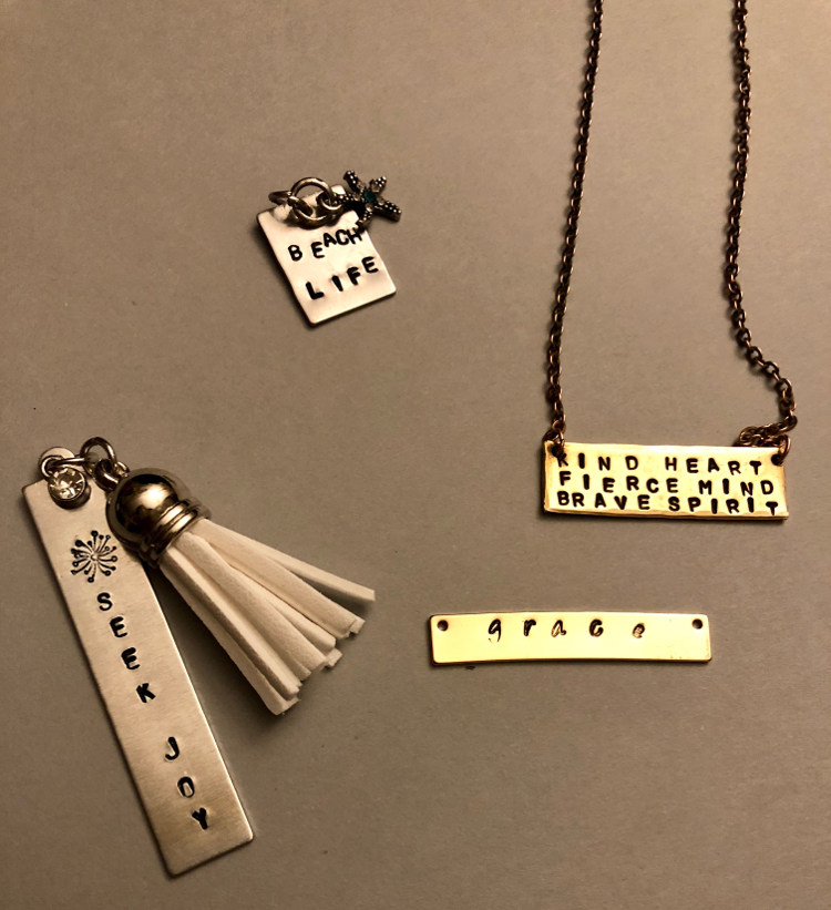 Featured here: Metal stamped jewelry by Beth Laurie that will be available at Sunday's sale.