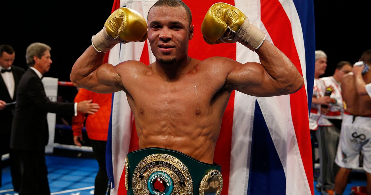Chris-Eubank-Jr-celebrates-with-the-belt-after-winning-his-fight-with-Renold-Quinlan.jpg