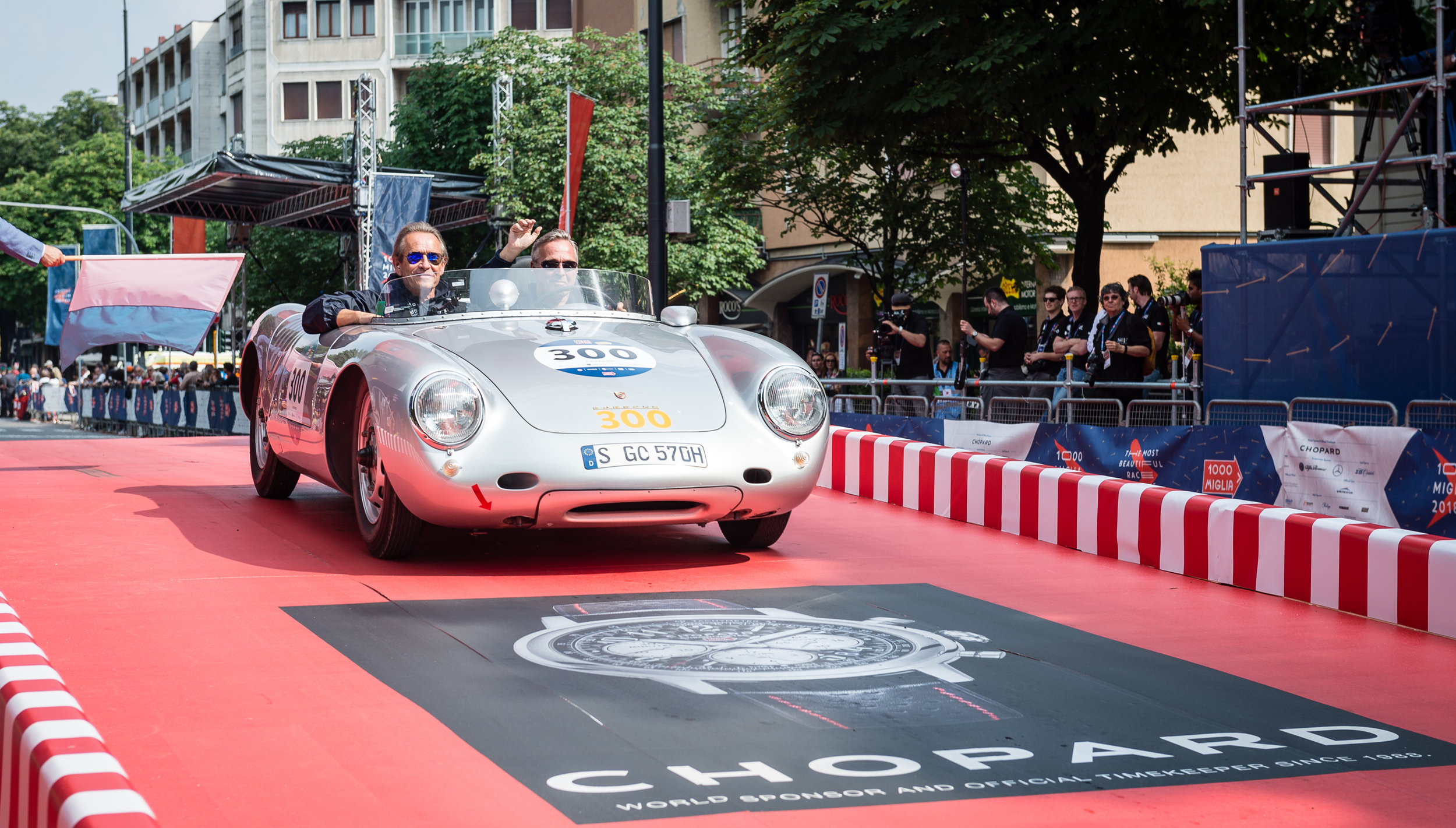 Karl-Friedrich Scheufele and Jacky Ickx leaving the famous ramp of the Mille Miglia for the 1000 miles race..jpg