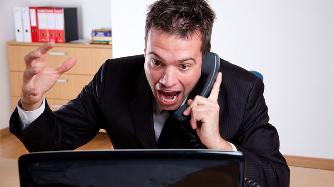 Man-Angry-at-Computer-on-Phone-in-Office.jpg