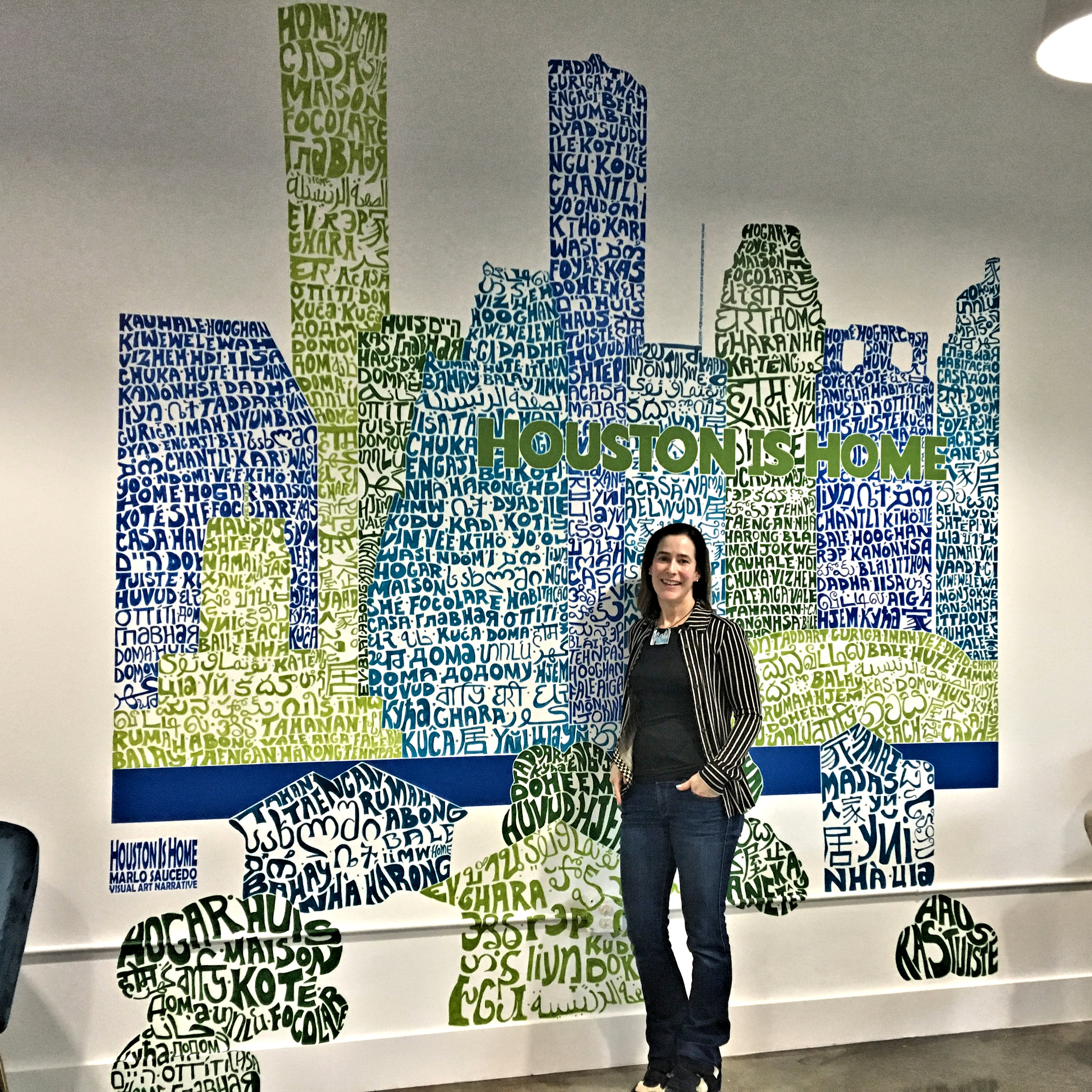 Mural : Boulevard Realty - Boulevard Realty commissioned a 7' x 9' mural, Houston Is Home, a skyline made of the word home written in 140+ of the diverse city's spoken and recognized languages, for their new multipurpose community/office YourSpace space, 927 Studewood, Houston, TX, 77008.