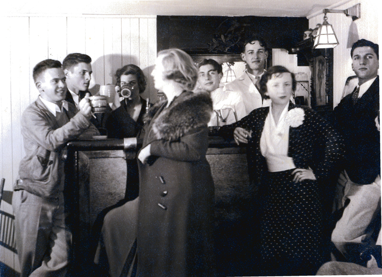 """Tash (hiding behind coffee cup) and her college pals in """"the speakeasy"""" in the basement of 430 Mission St."""