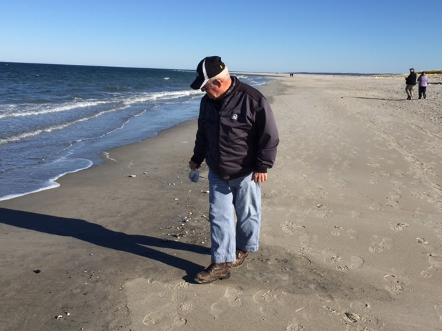 Dad picking up shells