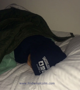 Liam sleeping in Smuggs gear