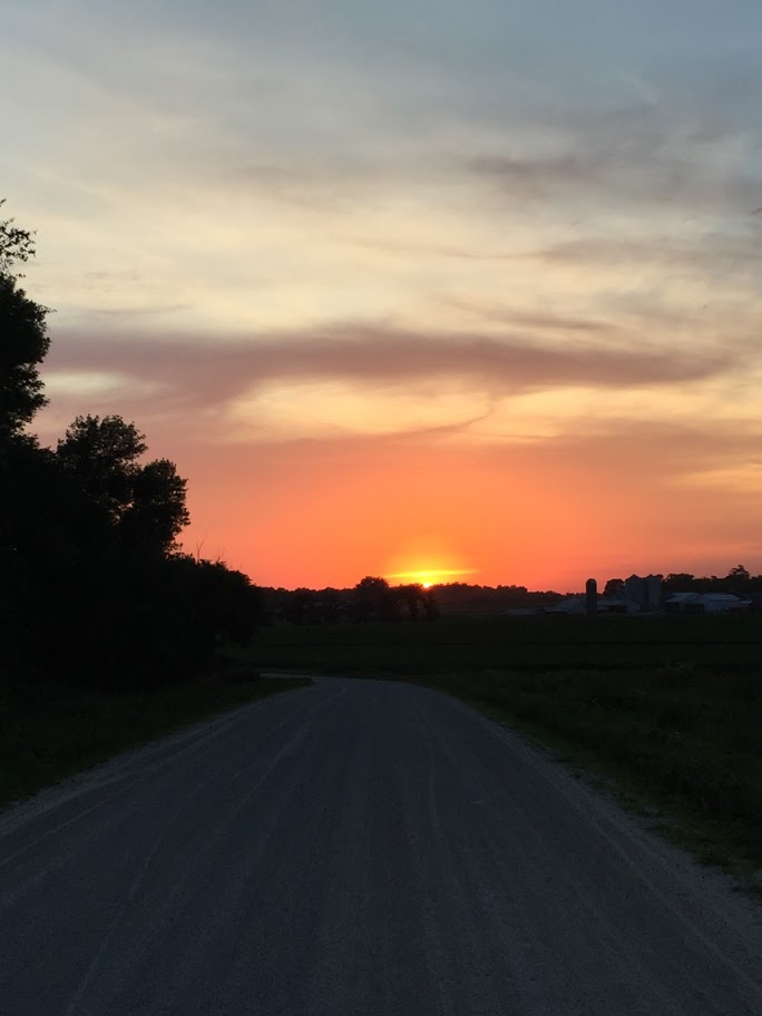 July sunset on gravel road.JPG