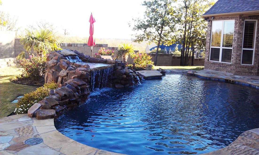 BMR pool and patio stone waterfall.jpg
