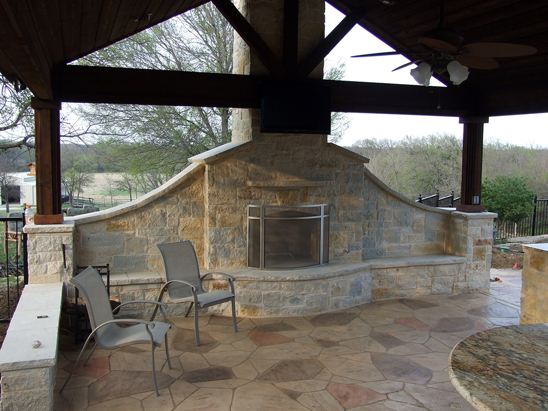 Bmr pool and patio stone white fireplace outdoor.jpg