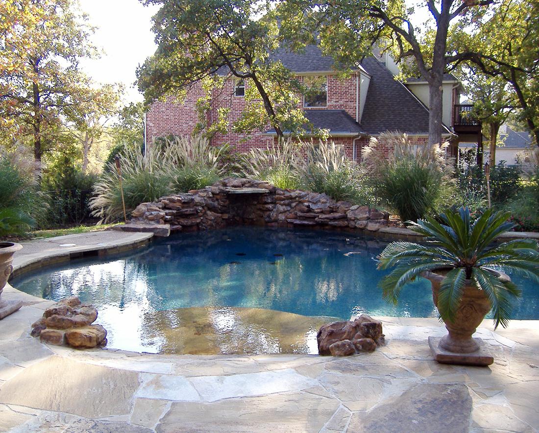 BMR pool and patio stone waterfall walk in.jpg