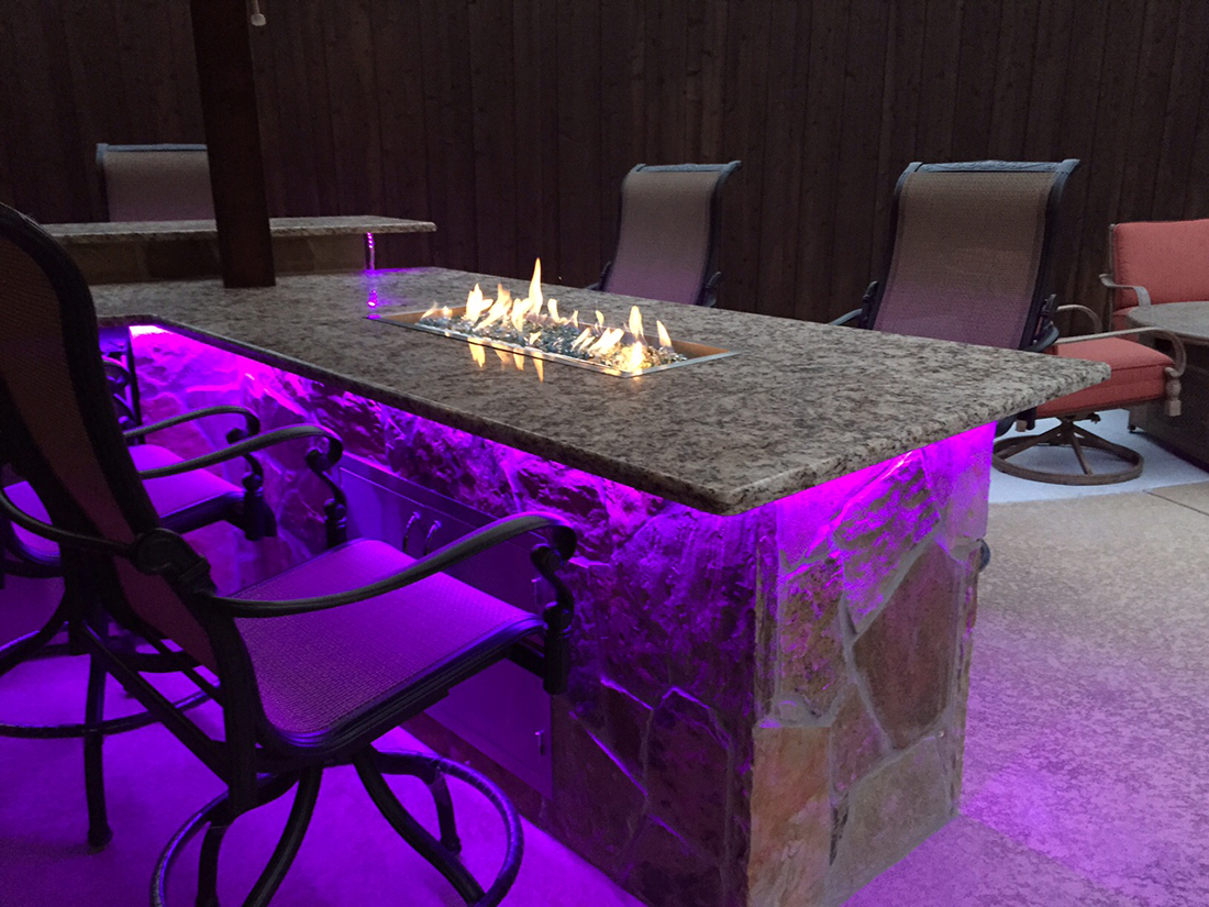 lit up fireplace bar bmr pool and patio.jpg