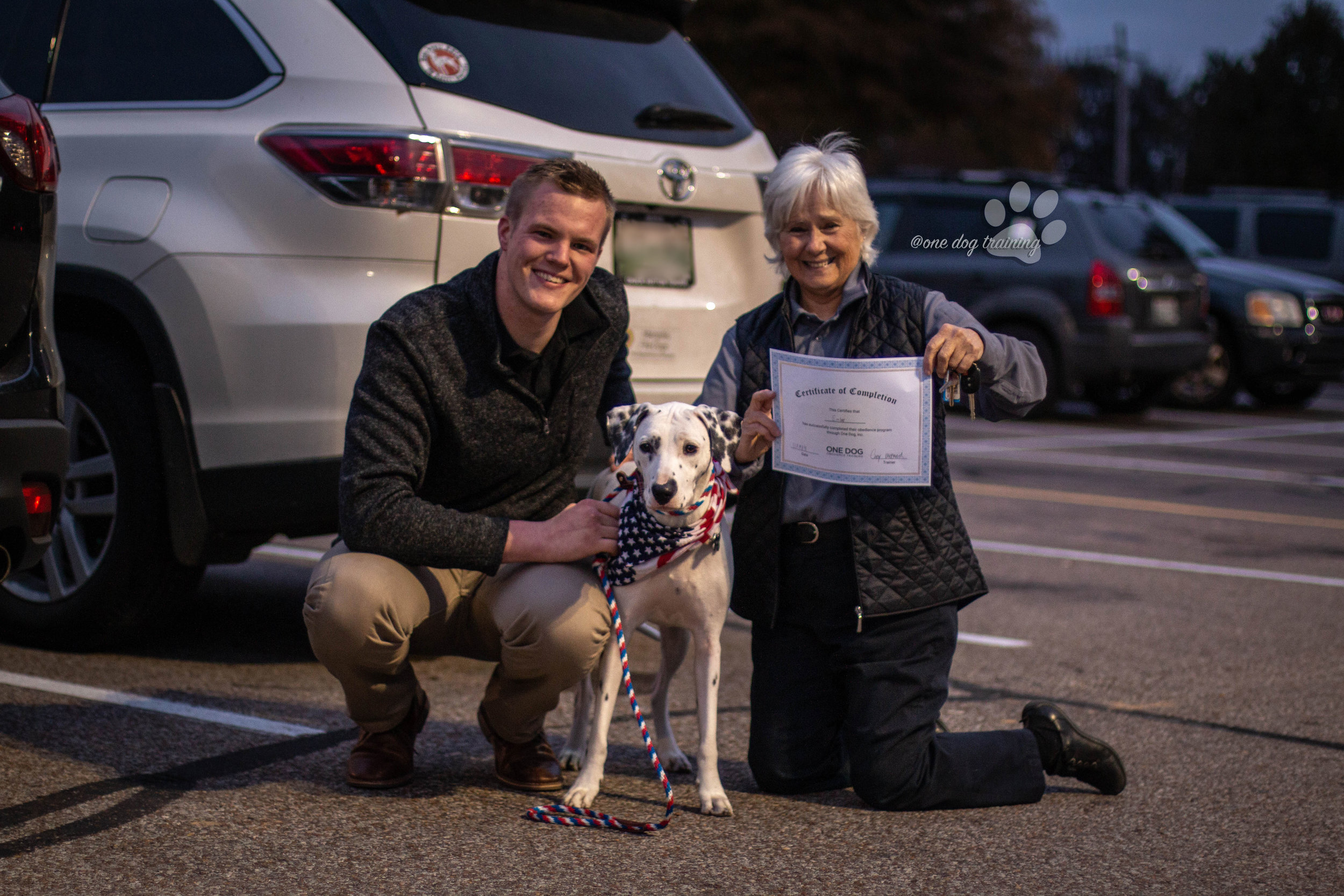 A happy client graduates from our obedience program.