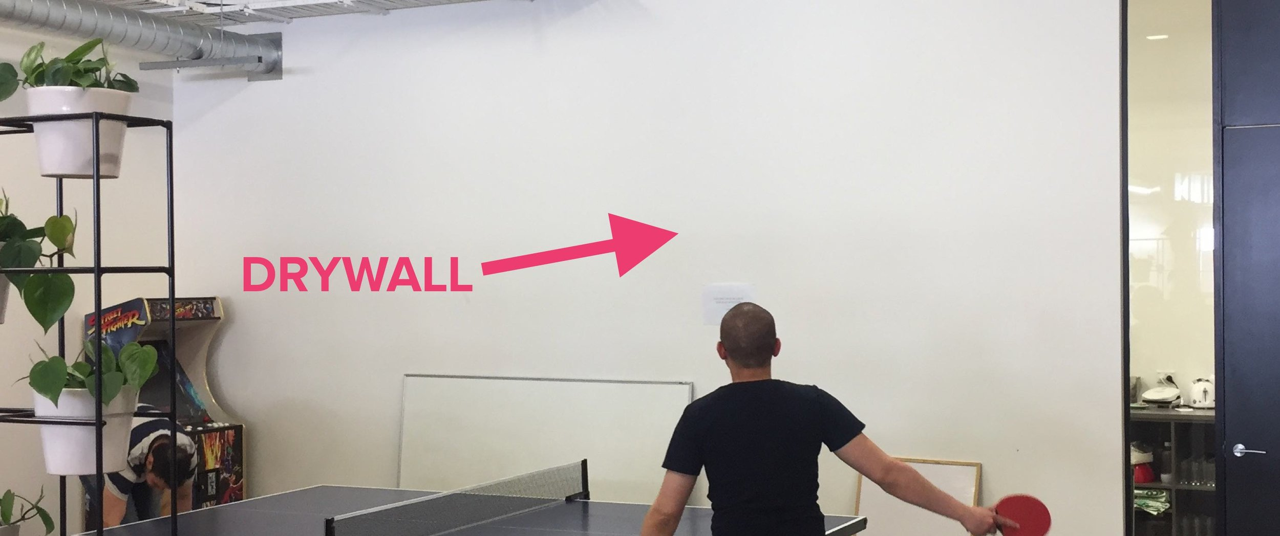 A photo of the drywall which separates our kitchen and table tennis area.