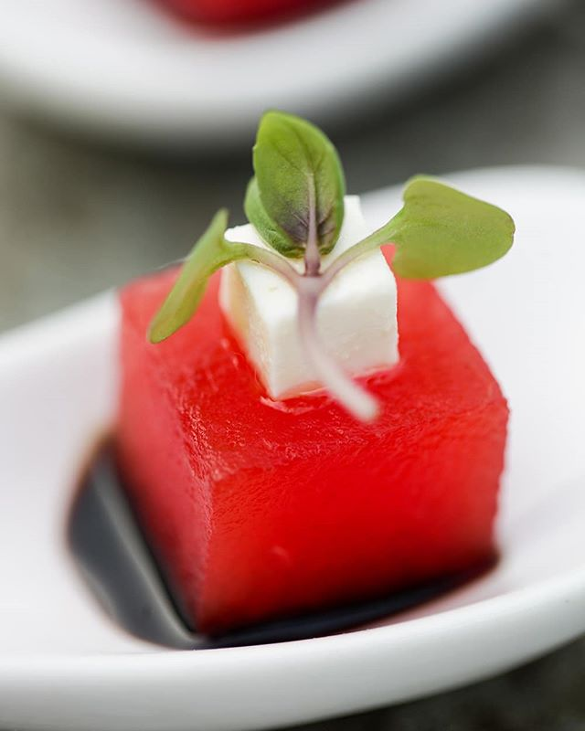 It's National Cheese Day and it's finally feeling like Summer in #SoCal so here's our Basil Infused Compressed Watermelon, Feta Cheese, Balsamic Reduction, and Micro Basil bite. Cheers! Photography by @hunkybrewster