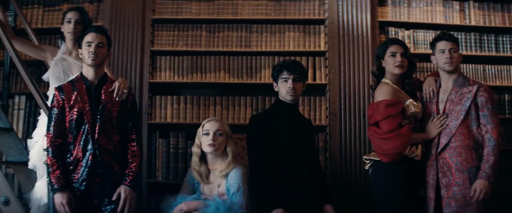 "A still of the royal family from the music video for ""Sucker.""  From left: Danielle Jonas, Kevin Jonas, Sophie Turner, Joe Jonas, Priyanka Chopra Jonas, and Nick Jonas"