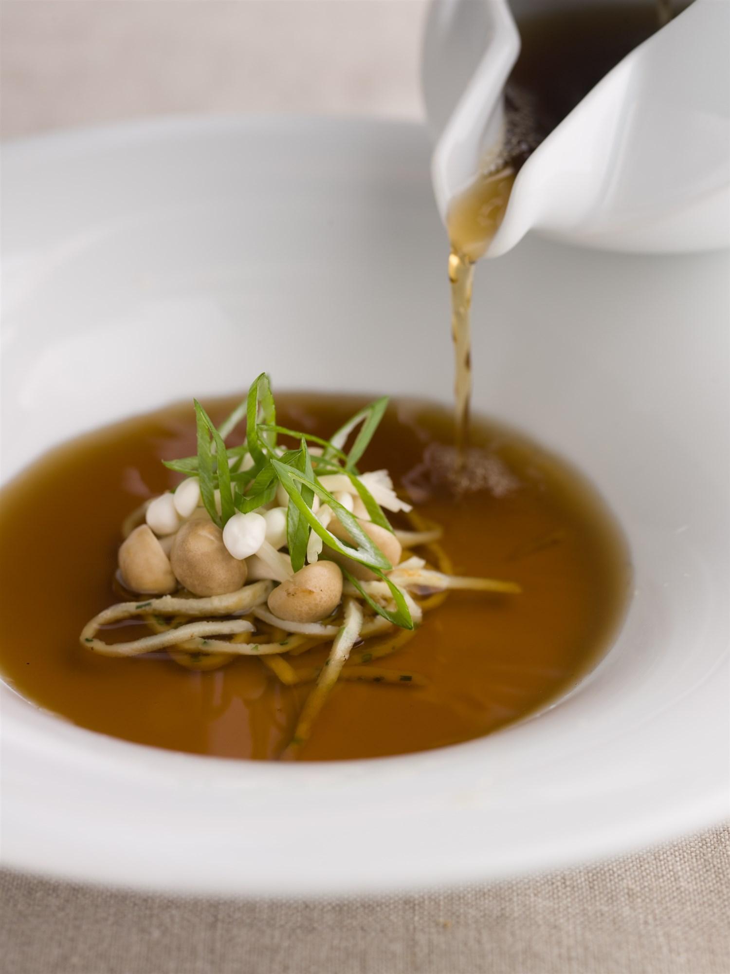 Mushroom consomme at  Araxi . John Sherlock | Courtesy Toptable Group