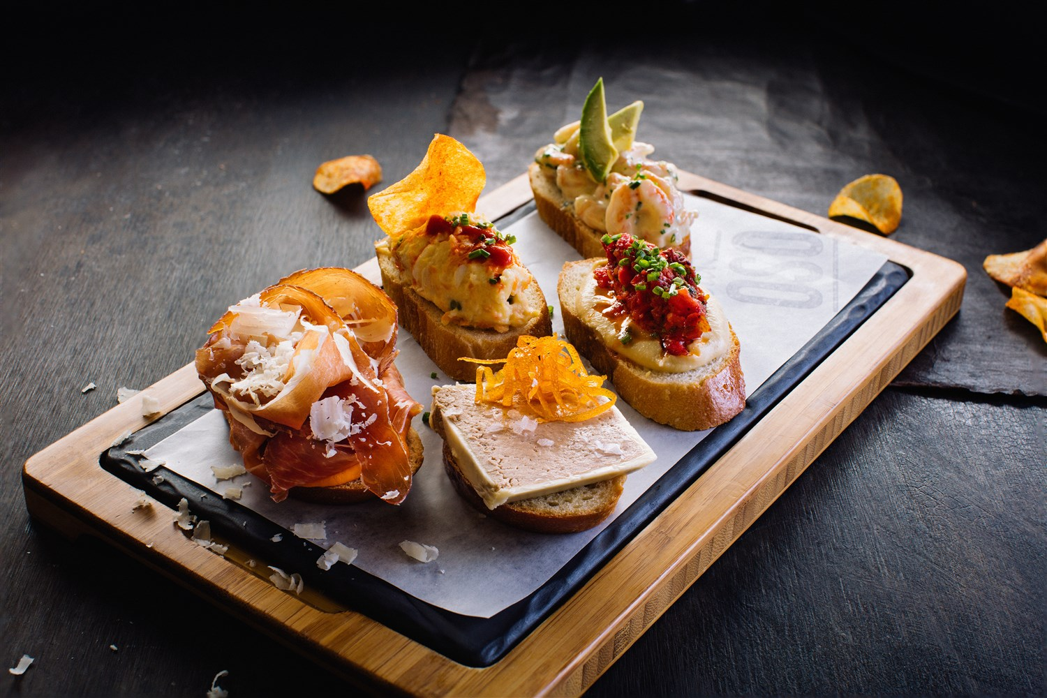 Montaditos are delicious and creative little sandwiches elemental to true Spanish tapas.  Bar Oso 's line-up includes a montadito of matane shrimp with avocado and yuzu, another of duck liver parfait with orange zest, a glorified ham and cheese with serrano, manchego and a romesco sauce, and more.  Kevin Clark | Courtesy Toptable Group