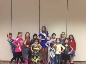 Grace posing with a local girl scout group!
