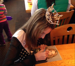 """Grace signing autographs and meeting new friends at the """"Pancake Breakfast"""" fundraiser!!"""