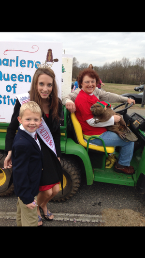 Grace and Grant posing for a picture with Charlene the Beaver at the Anderson County Christmas Parade.