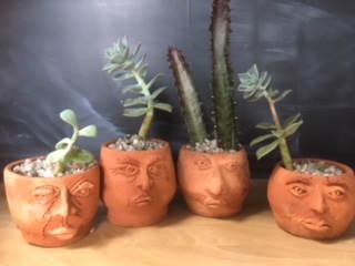 Face Pots with Succulents - $35 each