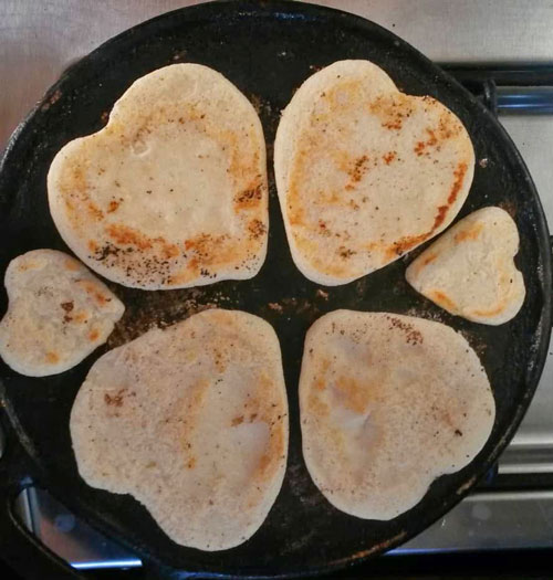 Cooking arepas a la plancha, Alvarado-koscinski family style.