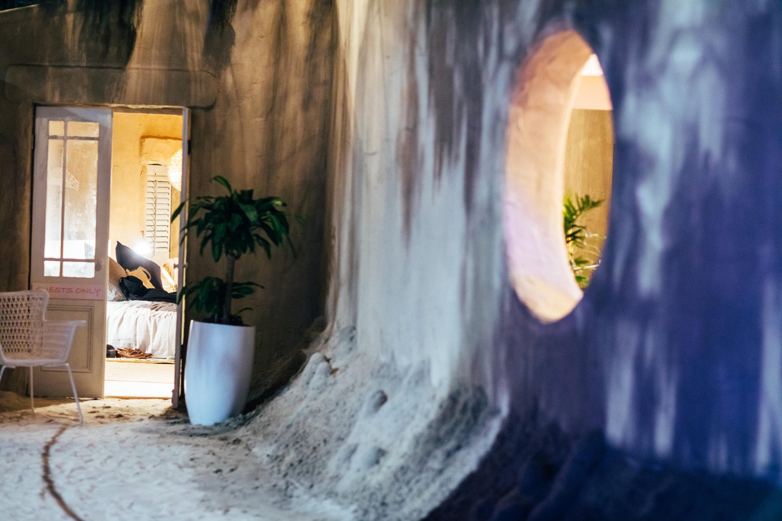 Sand hostel through to bedroom.jpg