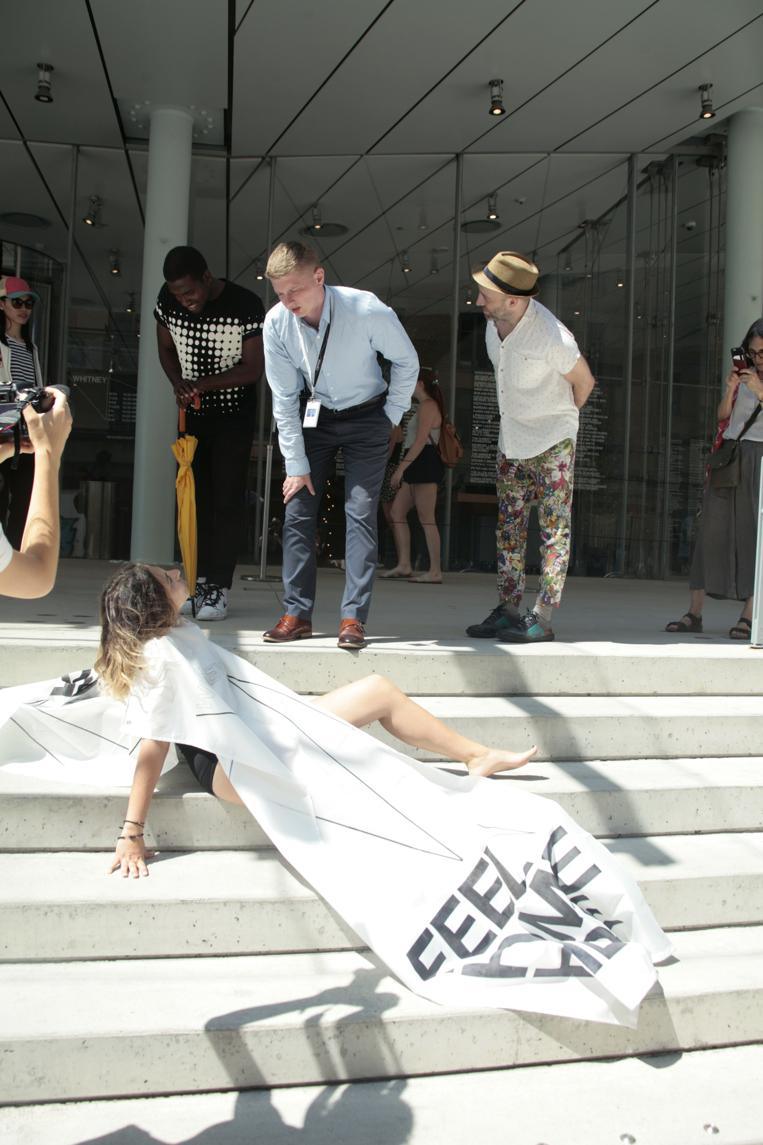 """Feel Home Here; Feel Local Here, Feel New York Here. ( Performance at the entrance of the Whitney Museum of American Art, New York.2018) The security manager of the museum asked me to leave the steps since """"that action"""" is not allowed..I had to come back to the part of the sidewalk owned by the Whitney."""