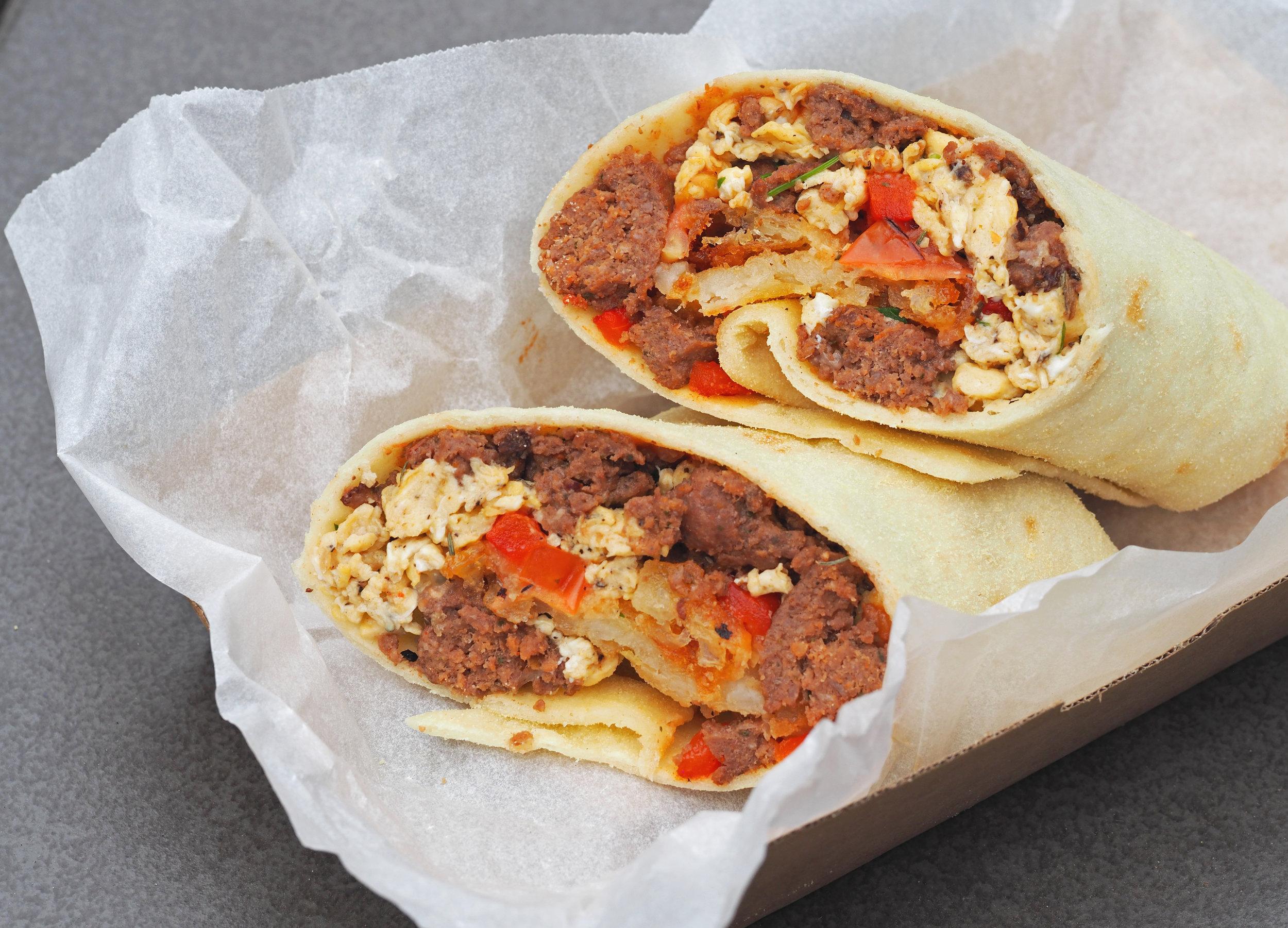 Kangaroo sausage breakfast burrito  with native thyme mushrooms and wattleseed scrambled egg .