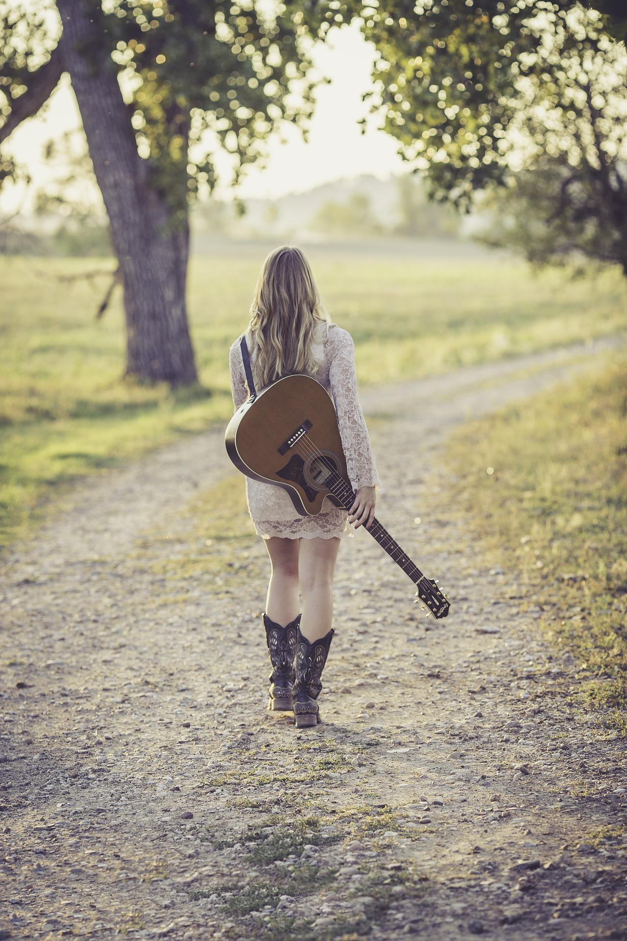 Girl with guitar  https://static1.squarespace.com/static/5a2a6968cd39c3b1cd28b7c6/t/5ce0c9bc3e2672000190ef39/1558235581673/guitar-946701_1920.jpg?format=1500w