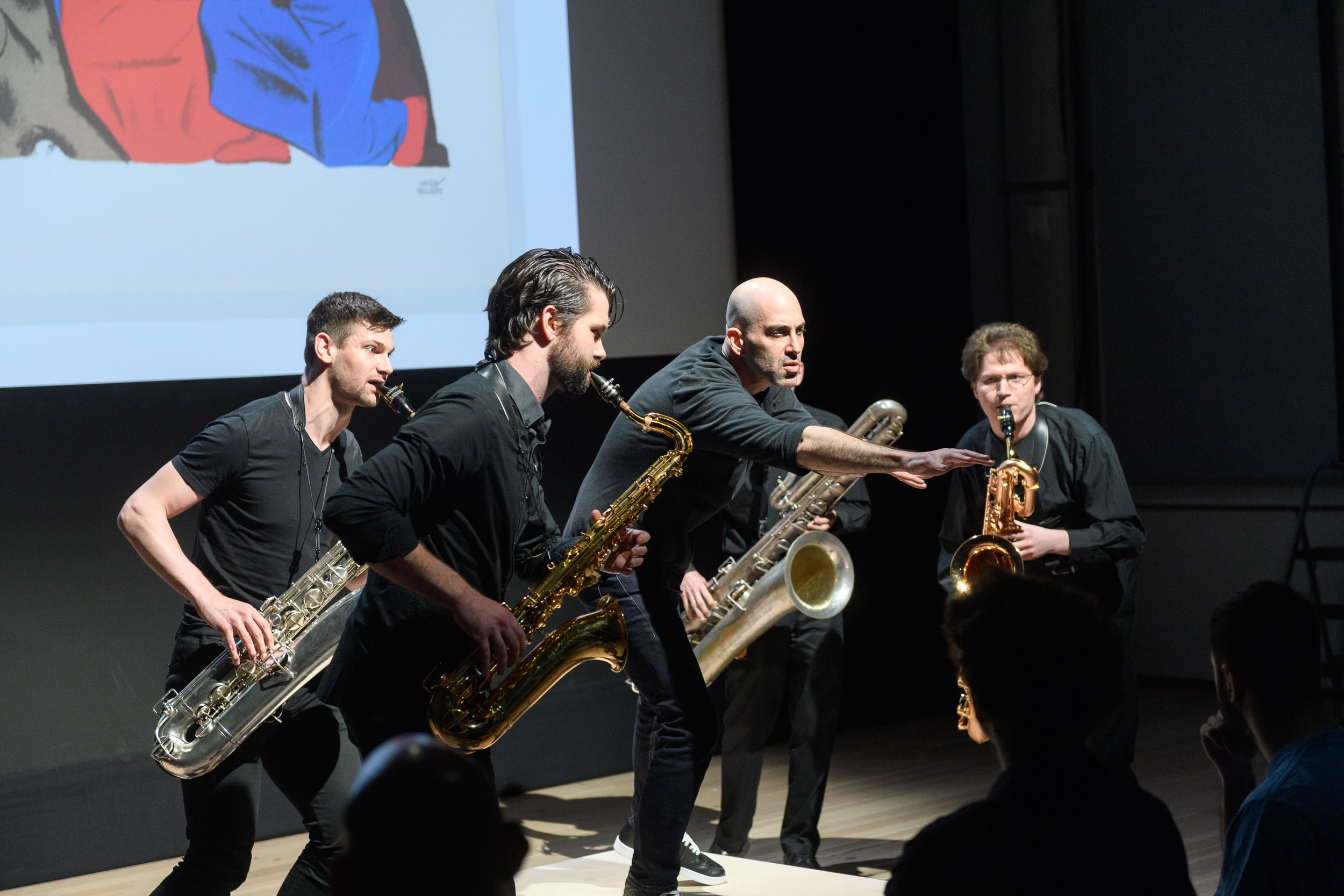 Performance at The Whitney Museum of American Art with ASL Slam   Pictured (left to right): Thomas Giles (Baritone Saxophone), Cole Belt (Tenor Saxophone), Douglas Ridloff (Visual Poet), Ryan Mantell (Bass Saxophone), and Joshua Lang (Baritone Saxophone).