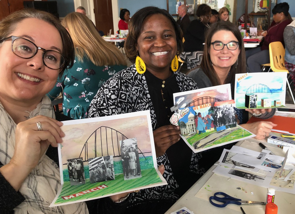 Participants in Bicentennial Workshops create pop ups depicting the Selma to Montgomery March.